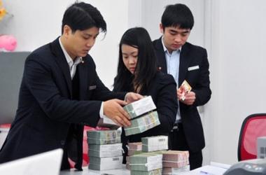 Bức tranh lợi nhuận của hệ thống ngân hàng năm 2014: Thế nào?