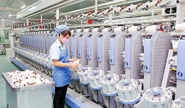 Tác động tràn của FDI tới tăng trưởng năng suất của doanh nghiệp dệt may Việt Nam: Cách tiếp cận bán tham số